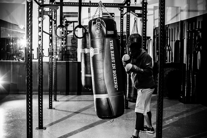man punching bag at gym
