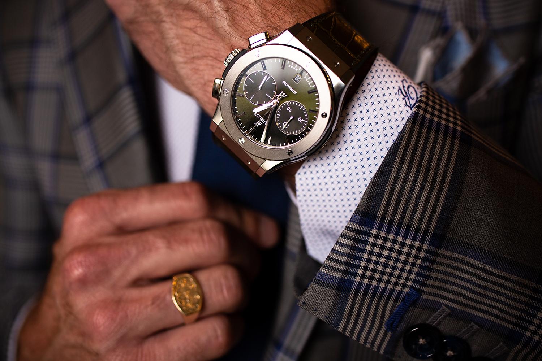 Hublot big gang on mans wrist wearing a Richards Bespoke suit.