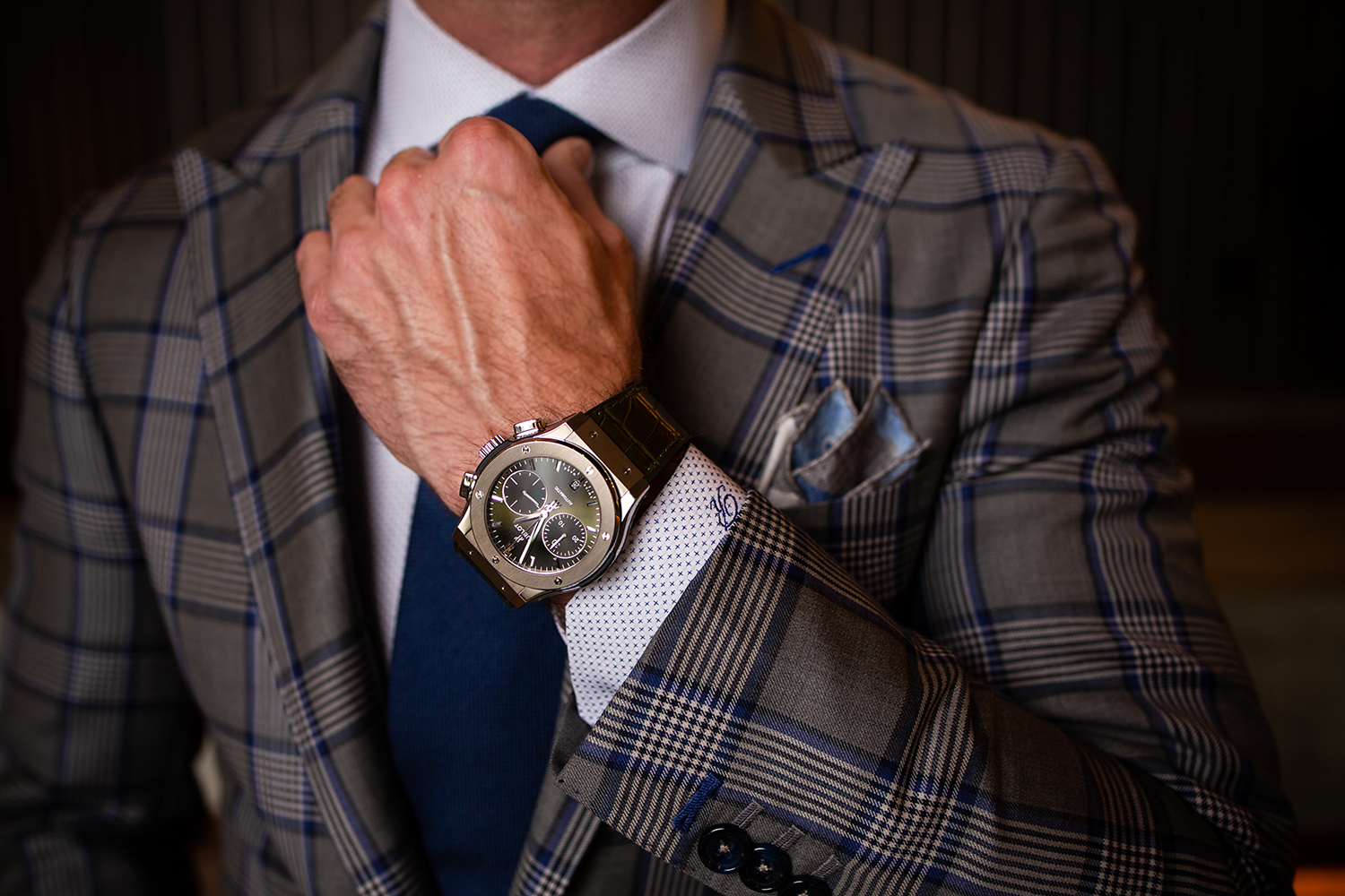 Hublot Big Bang worn by man wearing custom suit designed by Richards Bespoke