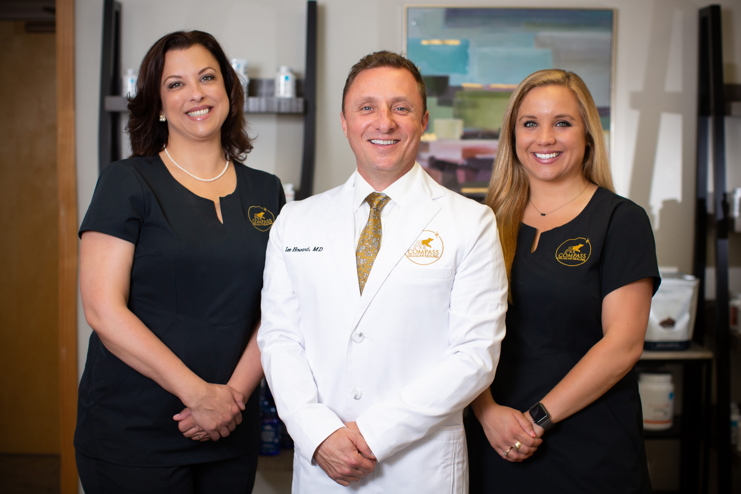Physician in white coat with staff