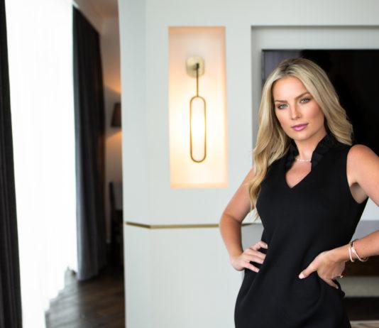 Beautifuk woman in black dress in hotel room