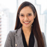 Portrait of smiling Asian businesswoman standing in the office